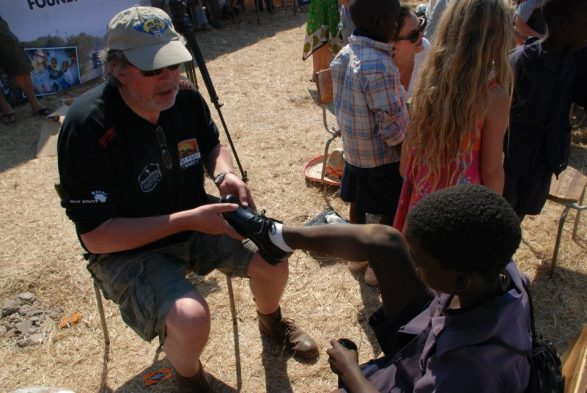 David fitting shoes in Livingston, Zambia